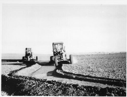 Constructing contour banks with a Booleroo plough in the 1960s.